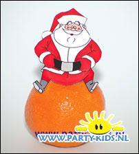 Kerstman op mandarijn